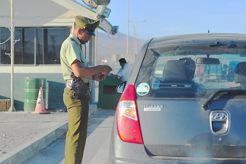 A driver at a police checkpoint undergoing check.